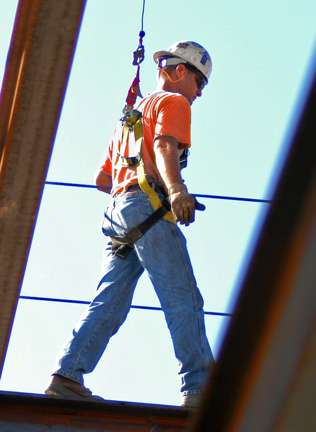 Construction worker wearing fall harness