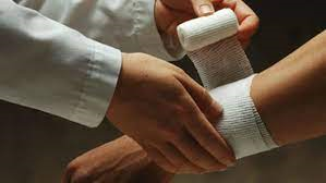 doctor wrapping patient's wrist