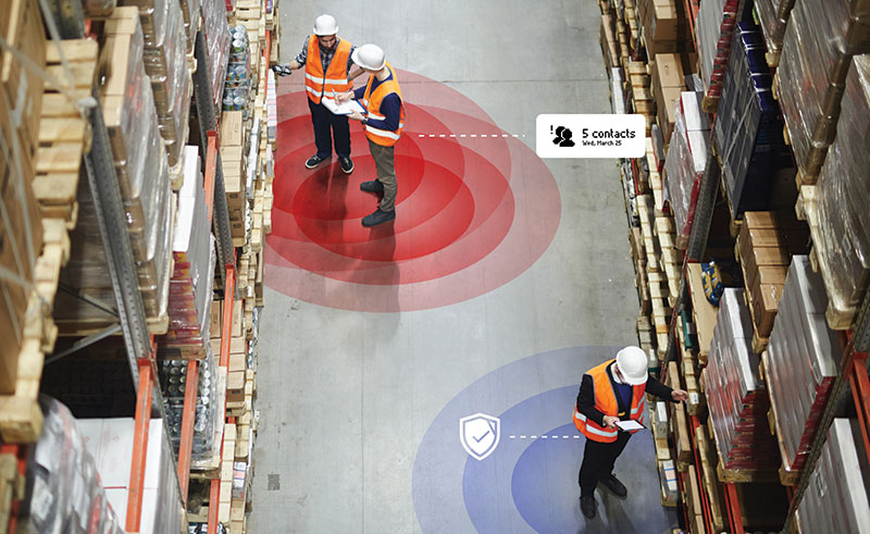 Aerial of workers standing in warehouse